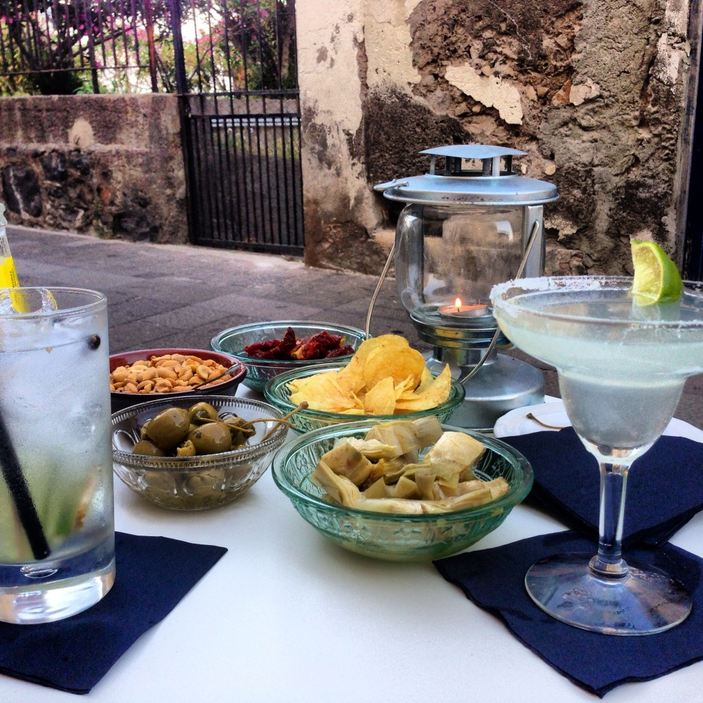 Sunset cocktails and delicious snacks at i cinque balconi on the island of Salina, Sicily