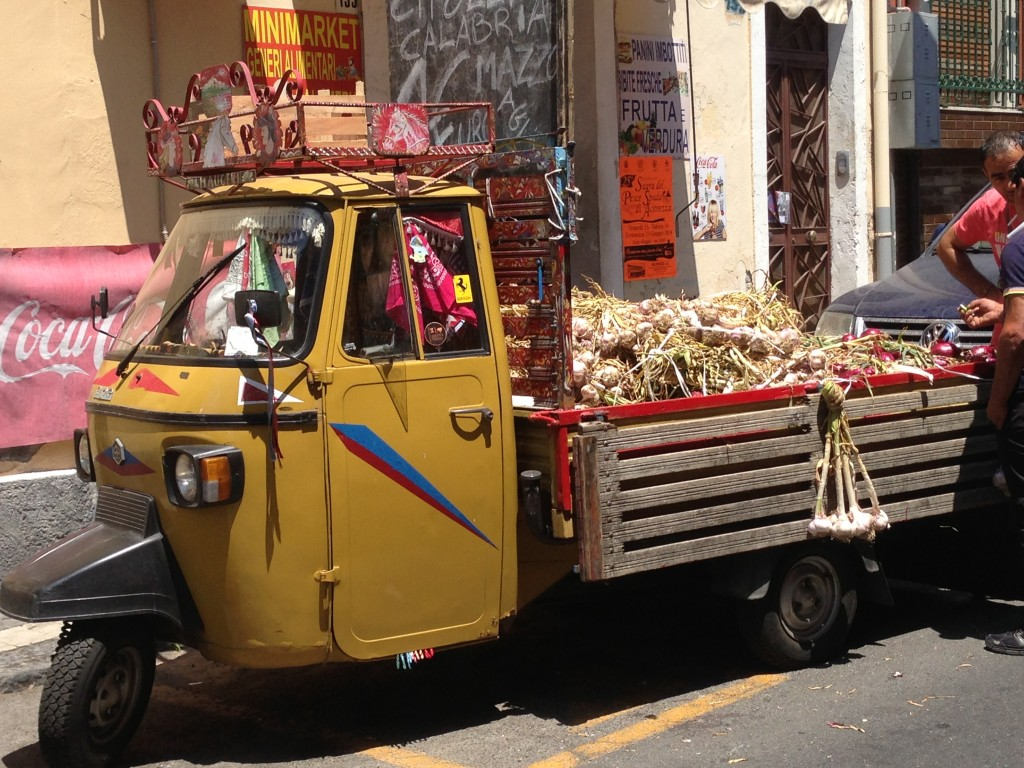 Ape selling garlic and onions Aci Trezza Sicily