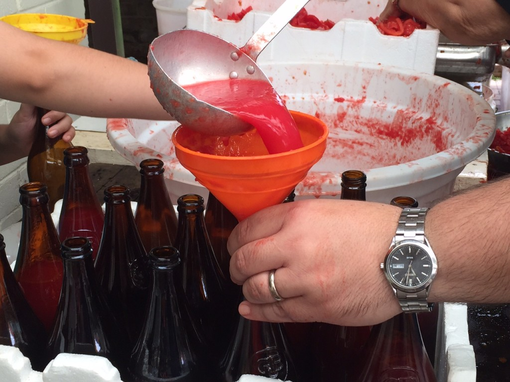filling the passata bottles