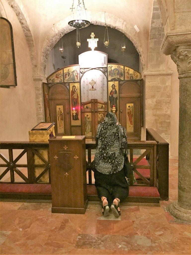 pilgrim worshipping, Basilica di Santa Nicola, Bari Vecchia